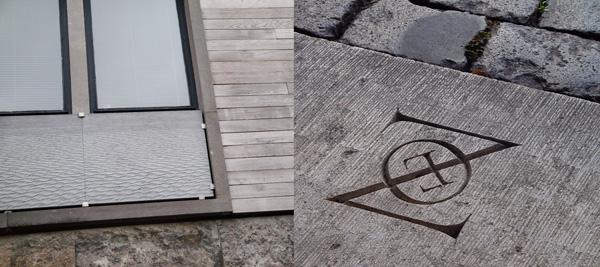 Le sculpteur Benoit Luyckx travaille la pierre bleue comme si elle pouvait se modeler dans des formes organiques, bien loin des fractures du matériau originel. Il crée ainsi des panneaux de faible épaisseur pouvant orner un mur ou même jouer un rôle architectural comme des garde-corps pleins. Un nom sobrement gravé sur le piédroit d'une porte montre comment un détail offre une autre dimension à la pierre. / Lure (F) / M. Vox
